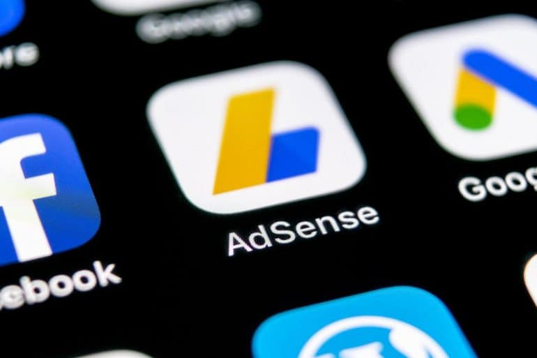 Google AdSense app icon on mobile showing the emerging email extortion scams that threaten to cut off ad revenue for publishers