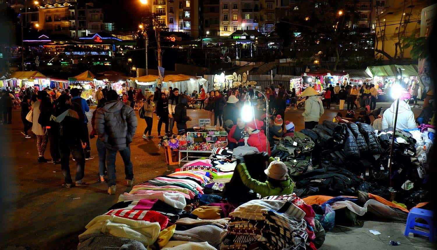 Crowded night market showing extremely low barriers to entry for spammers in the phishing ecosystem