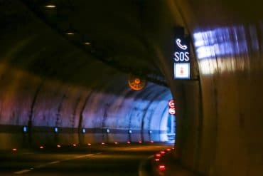 SOS sign in road tunnel showing Next Generation 911 systems are vulnerable to DDoS attacks
