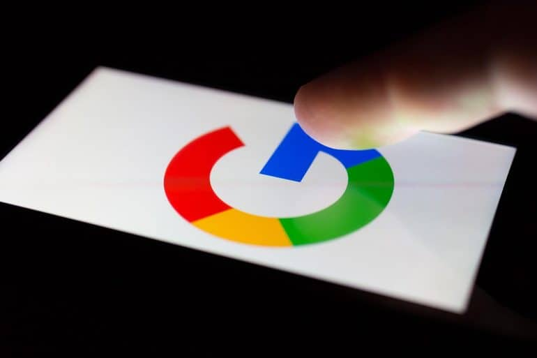 Smartphone lying on a table in the dark, displaying the logo of Google showing threat to GDPR protections post-Brexit