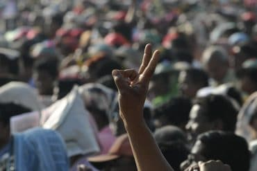 Indian man making victory sign in a crowd of people showing privacy advocates voicing opposition against India's proposed national data protection law