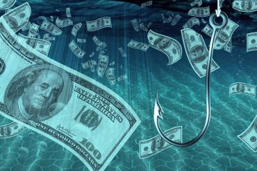 One hundred dollar bill on fish hook showing scammers using social media networks as favorite phishing spot