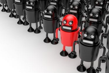 Red robot among black robots showing the hidden dangers of malicious bots