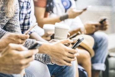 People using smartphone showing privacy behaviors of tech users