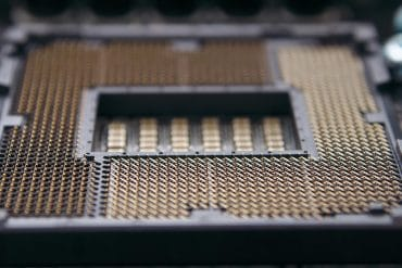 CPU processor socket on a computer motherboard showing the Intel chip vulnerability that impacts five years worth of computers