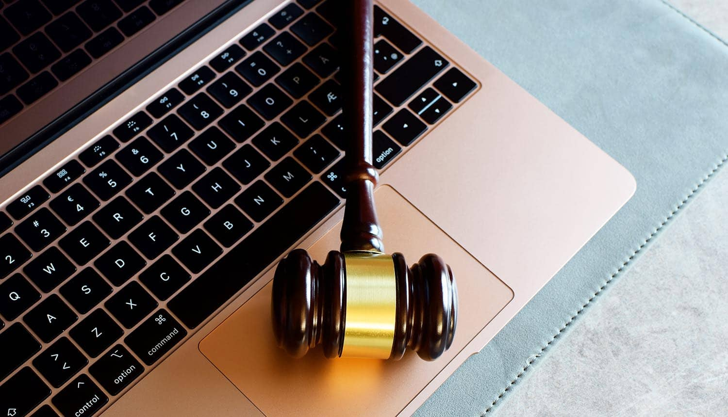 Gavel on laptop showing the need to have digital regulation to stay compliant with consumer privacy regulations