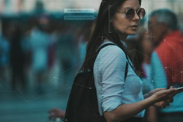 Facial recognition technology on a woman showing the breach of Clearview AI source code that renews concerns about law enforcement facial recognition programs