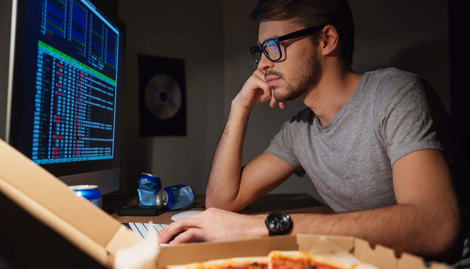 Programmer working on computer showing more hackers making use of software patches to create new vulnerability path