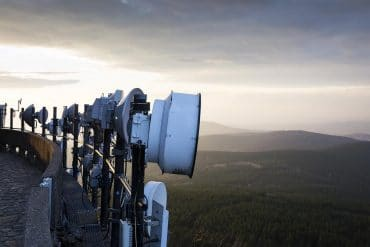 Transmitters on telecommunication tower showing how privacy is a key concern for mobile carriers when handling telco data