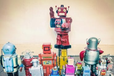 A group of toy robots showing the surging automated attacks by malicious bots
