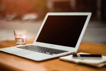 Laptop on desk showing data privacy tips for remote work