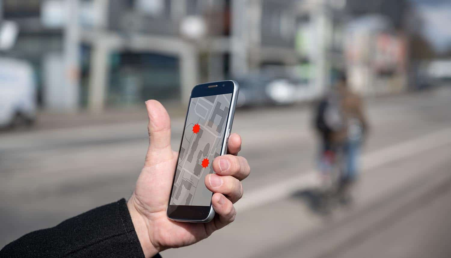 Man using tracking app on mobile showing experts questioning the usefulness of contact tracing apps