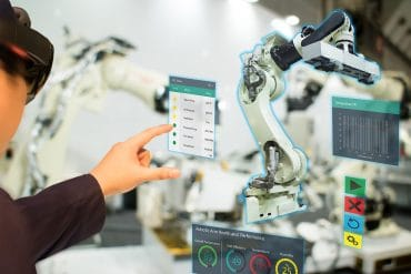 Engineer using AR device to work on machine showing the cyber threats of AR technology