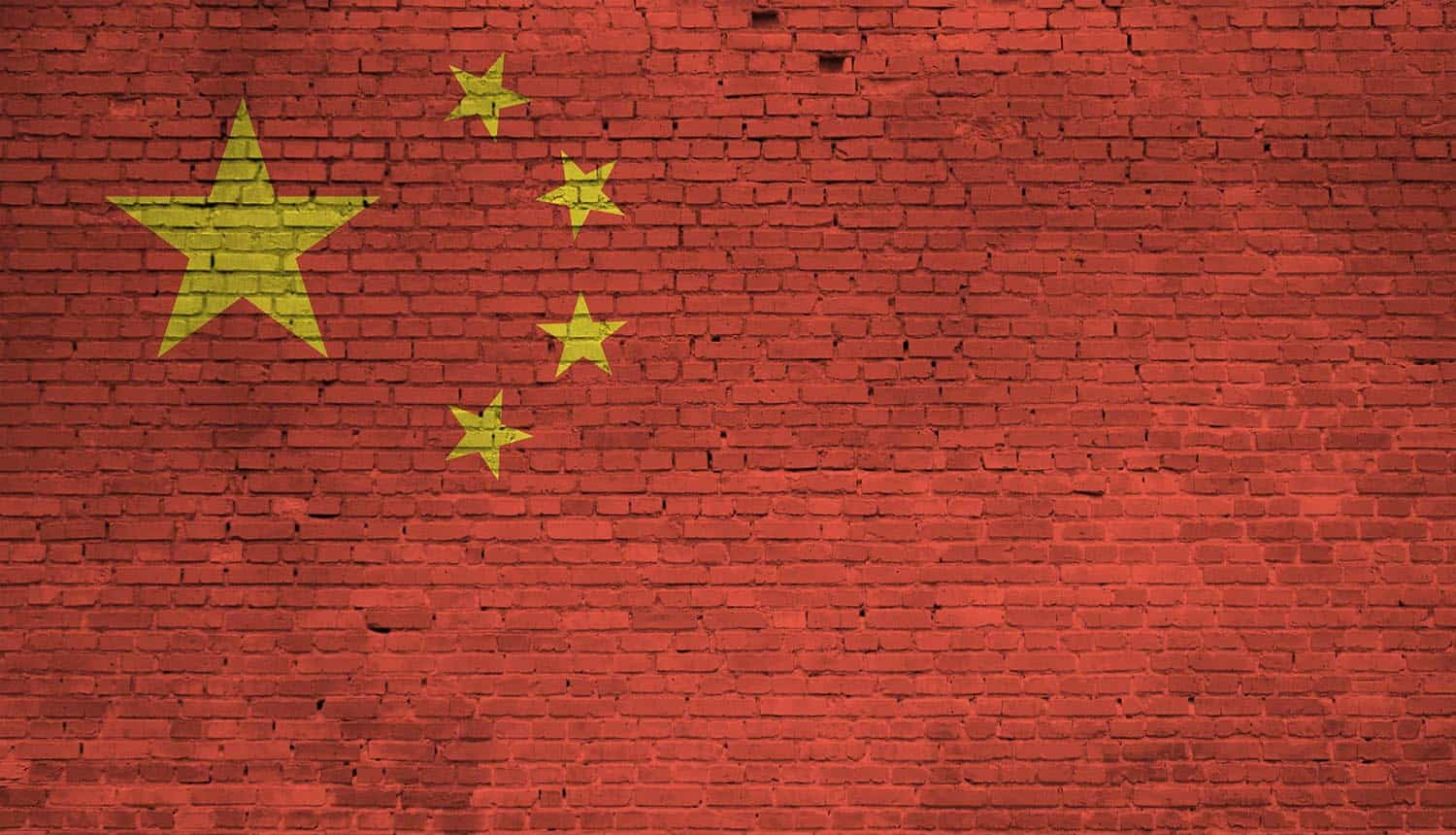 China flag painted on brick wall showing the expansion of privacy rights in China's new civil code