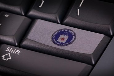 CIA flag on keyboard button showing declassified report indicating 2016 Wikileaks breach of CIA hacking tools was due to systemic failures