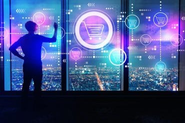Man touching virtual screen with shopping cart icons showing ecommerce retailers are not prepared for account takeover attacks