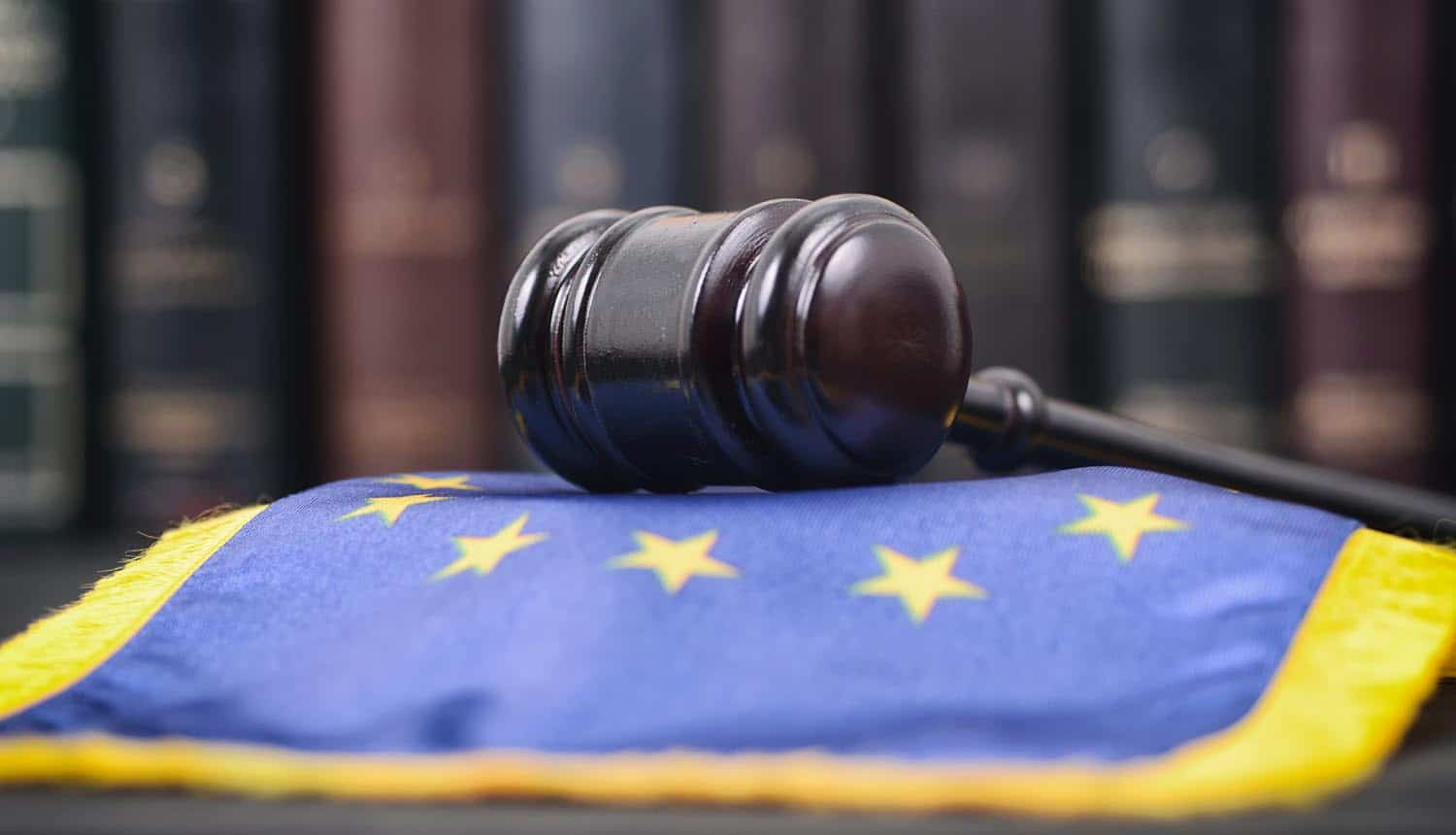 Gavel on EU flag showing the EDRi letter that highlights the disparity in GDPR enforcement actions and lack of resources to DPA
