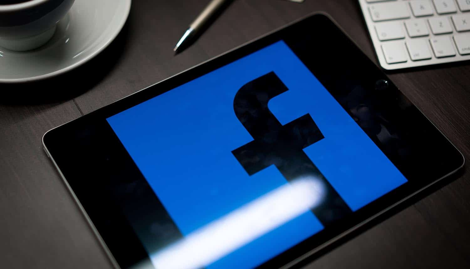 Facebook logo on tablet showing the concerns over Facebook's data collection and personalized ads after the merger of GIPHY and Instagram