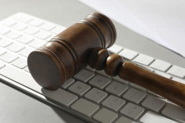 Gavel and computer keyboard showing the preparation needed to meet CCPA compliance
