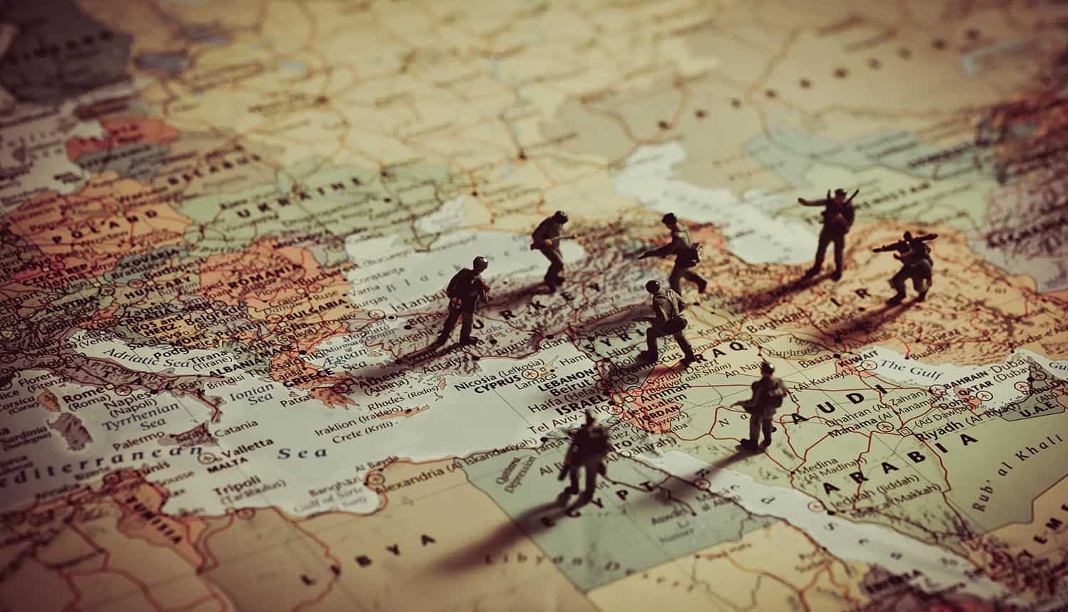 Toy soldiers on world map showing the hidden cyber war between Israel and Iran