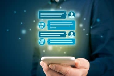 Man communicating with chatbot on mobile showing the use of intelligent chatbots in cybersecurity strategy
