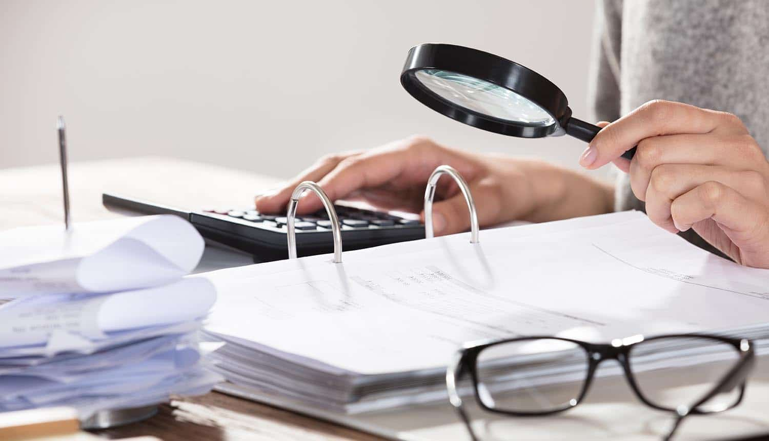 Businesswoman examining documents showing KYC process