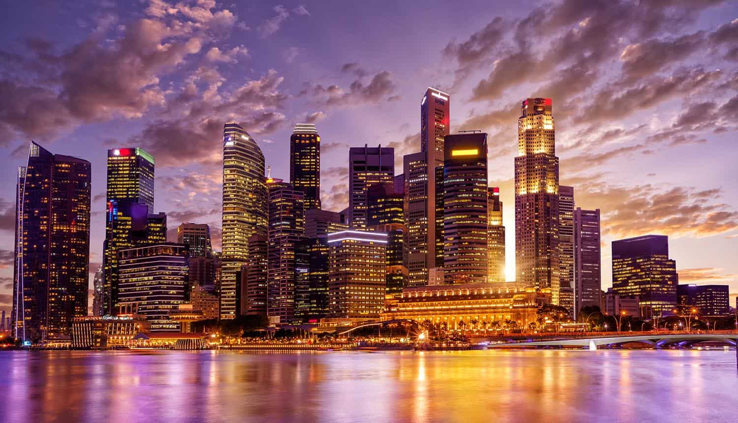City night view of Singapore showing the phishing and watering hole attacks that dominate Singapore's cyber threat landscape