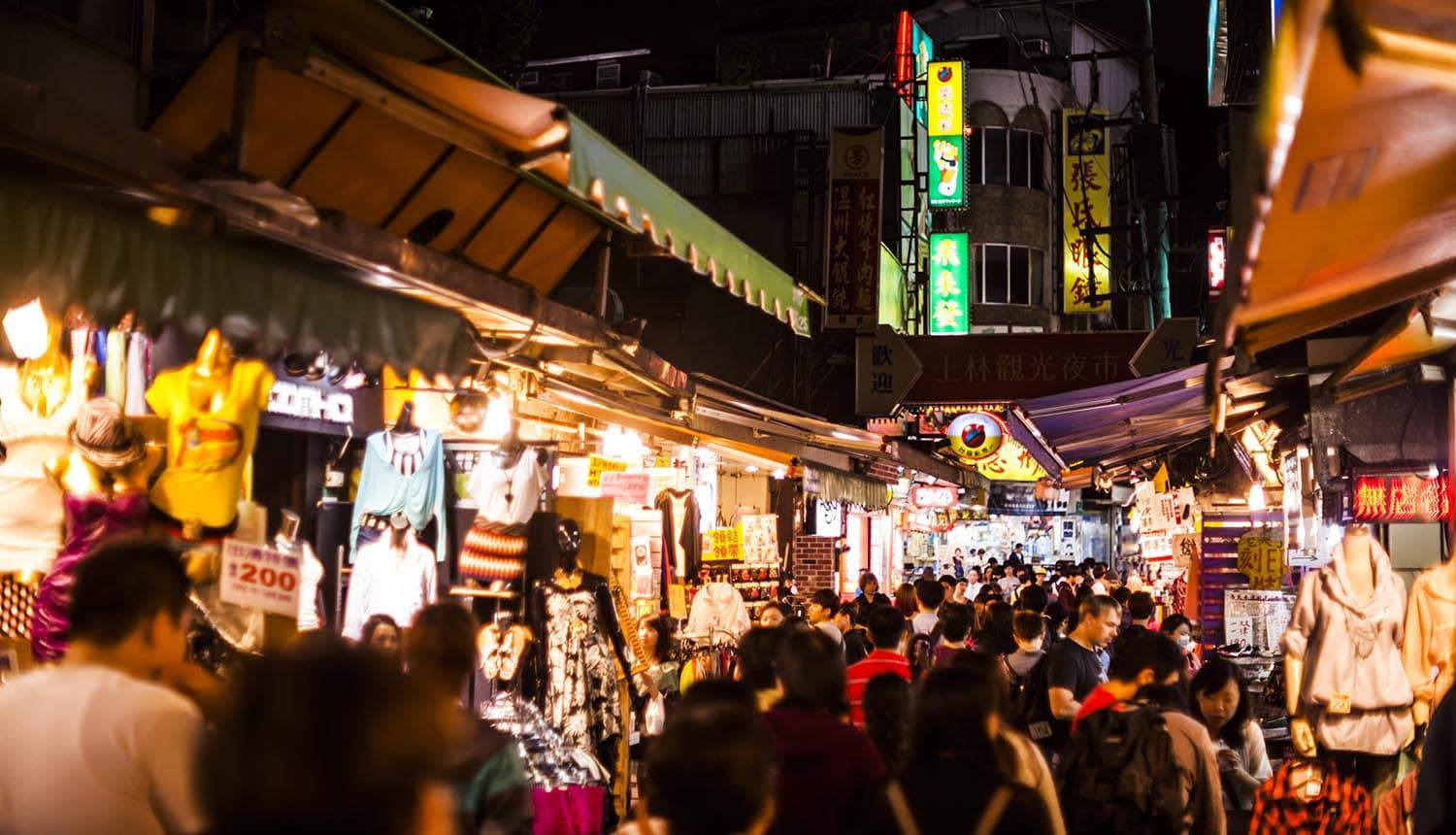 Crowd of people at night market showing the previously exposed credentials being recirculated in underground communities