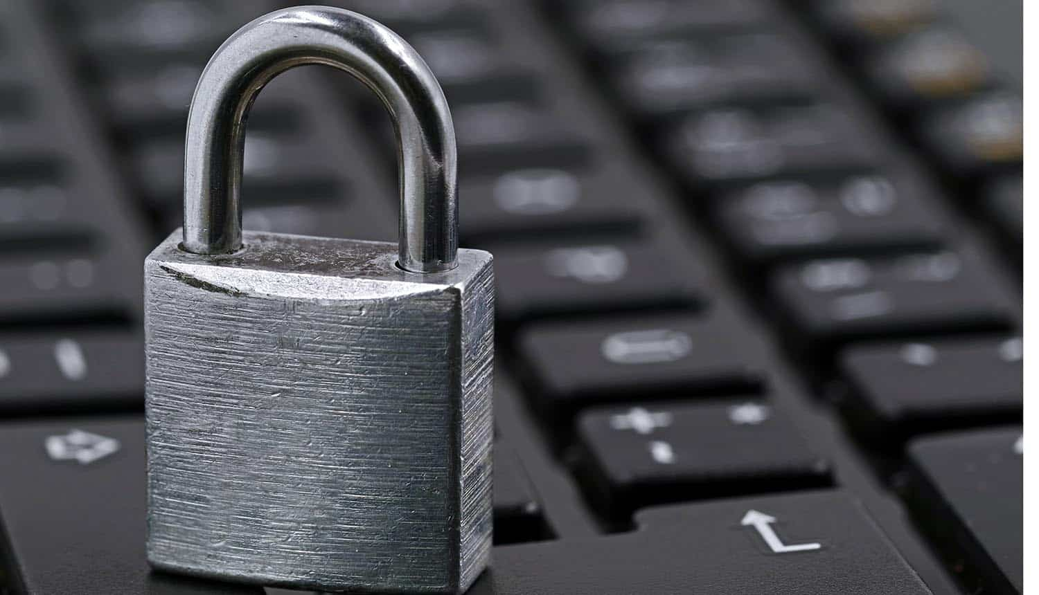 Padlock on keyboard showing the three reasons that stop companies from getting rid of passwords