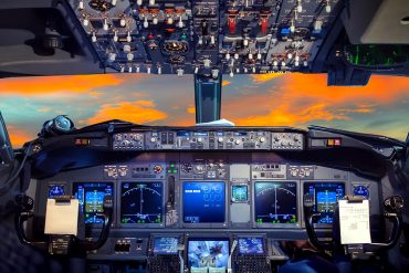 Airplane cockpit in sunset showing cybersecurity in aircrafts
