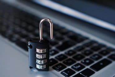 Padlock on computer keyboard showing need for cybersecurity
