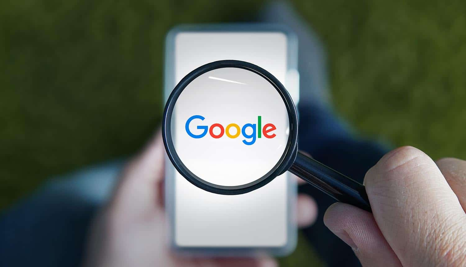 A man with a magnifying glass examines the Google logo on the smartphone showing privacy lawsuit on app tracking