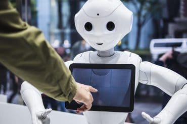 Man interacting with robot assistant