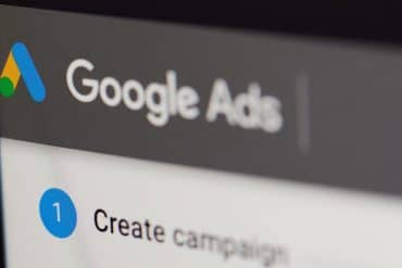 Create google ads campaign on laptop screen showing the long-running war between Google and European media companies over personalized ads