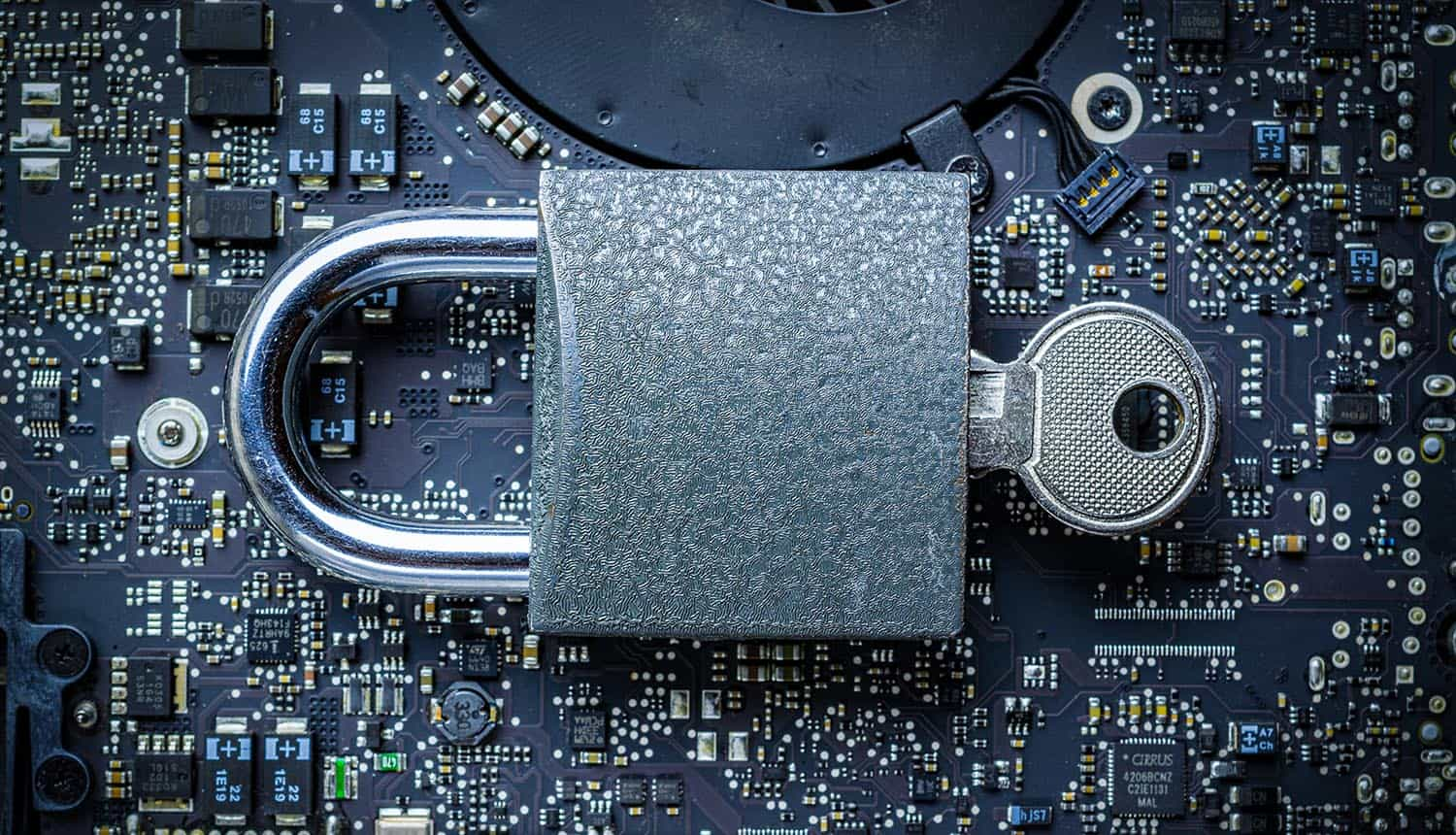 Padlock with key on computer chip showing the new proposed anti-encryption law that requires a backdoor on electronic device