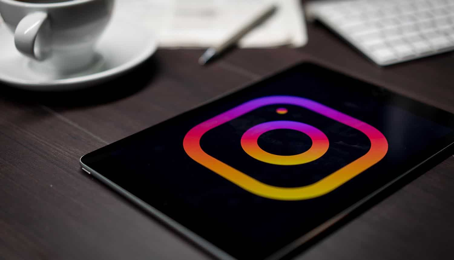 Logo of Instagram on tablet on office desk showing the need to protect your privacy