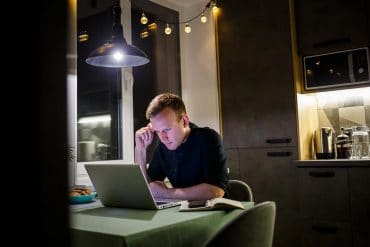 Man working at home showing how to run patch management effectively to secure remote workforce
