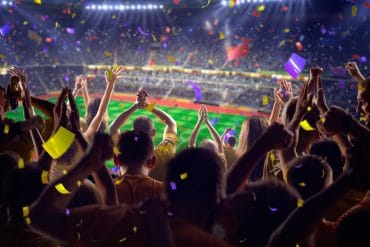 Fans in stadium soccer game showing sports industry not immune to cyber security threats