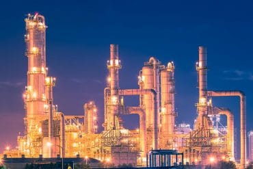 Night view of refinery plant showing the importance of ICS security to prevent cyber attacks on critical infrastructure