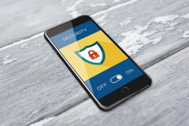 Smart phone with security on screen showing cybersecurity challenges when working from home
