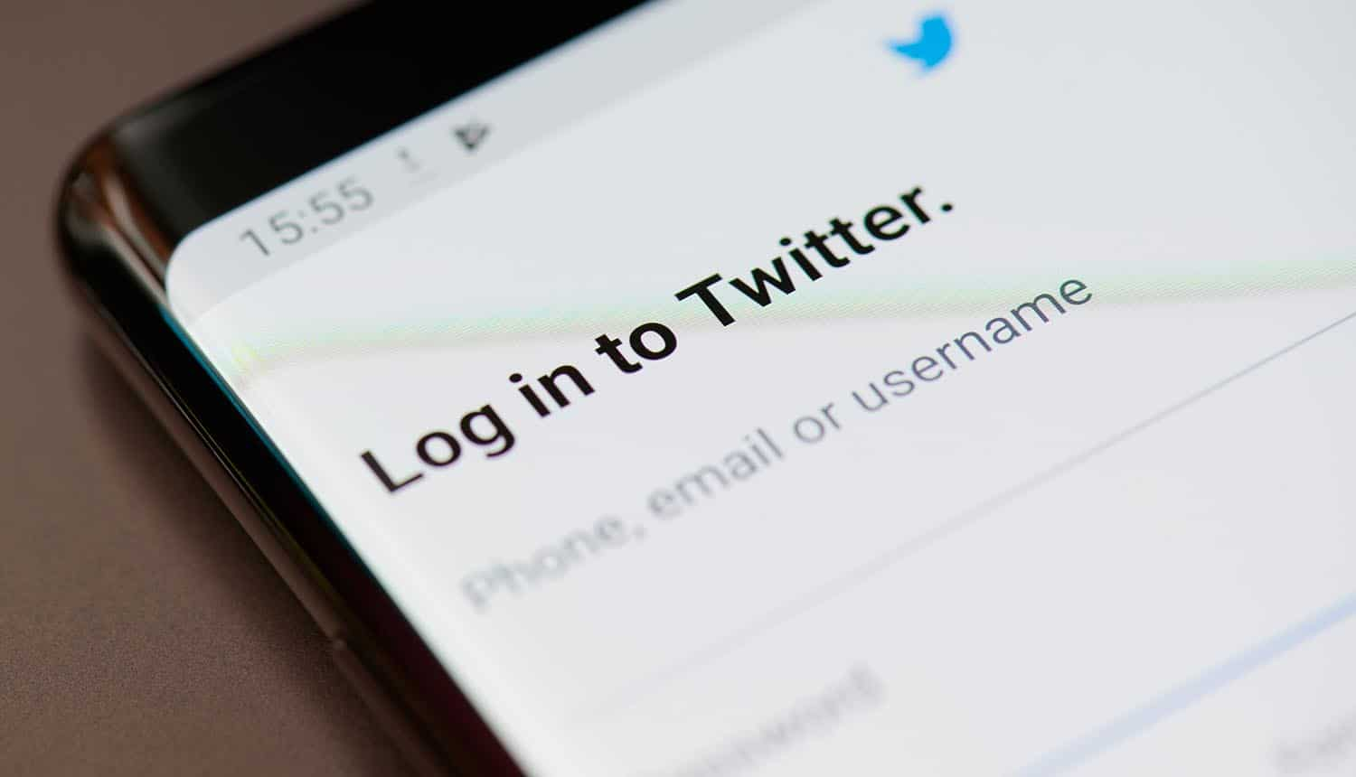 Log in to Twitter on smartphone screen showing Twitter hack