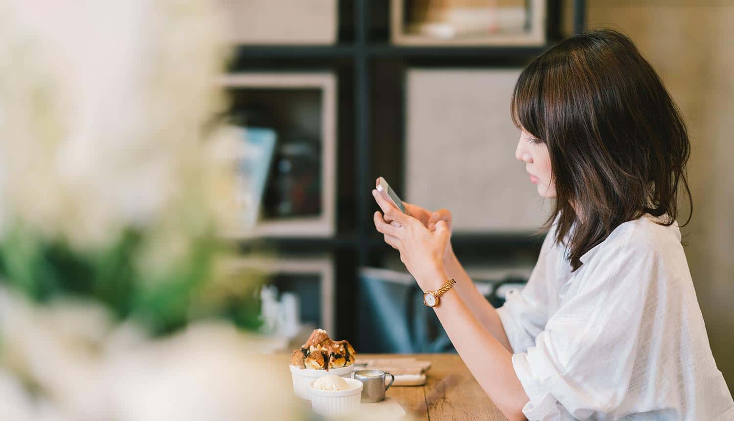 Asian girl using smartphone at cafe showing priority of convenience over personal data security