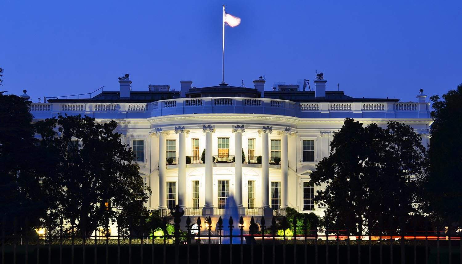 The White House at night showing WeChat and TikTok ban