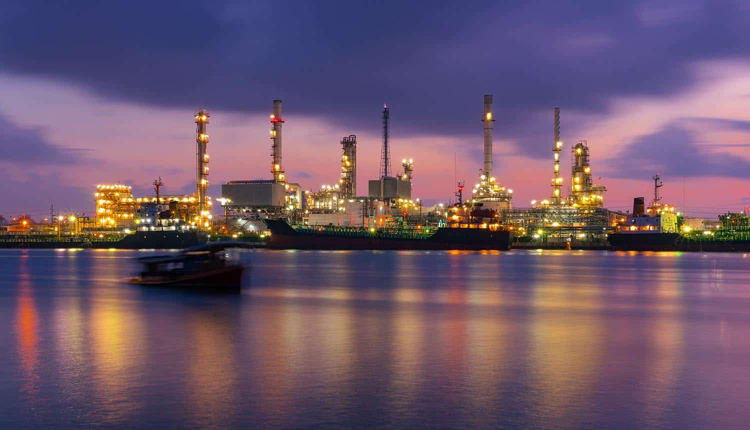 Sunrise at oil refinery factory showing cyber threats targeting critical infrastructure