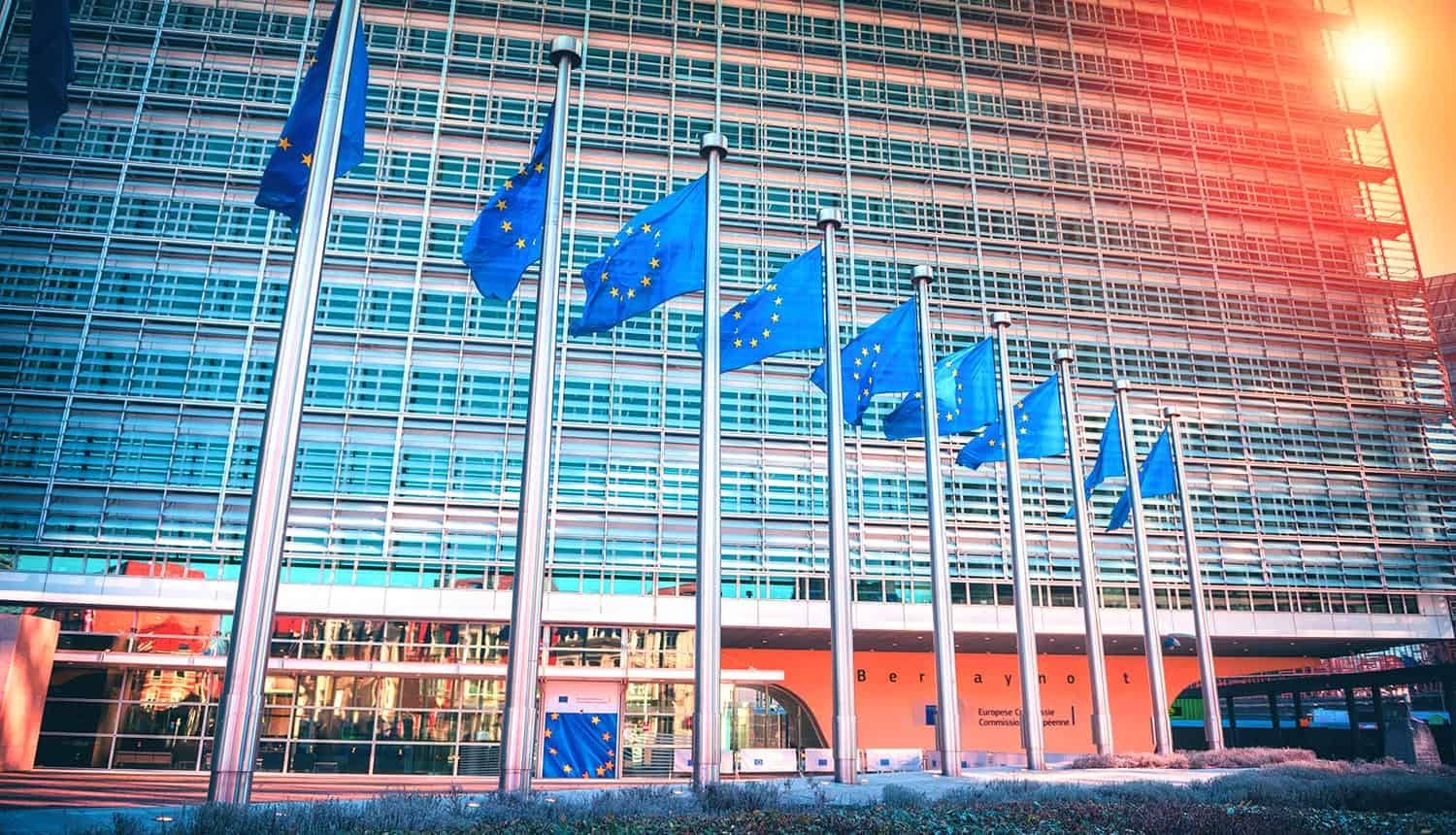 EU flags waving in front of European Parliament building showing invalidation of Privacy Shield