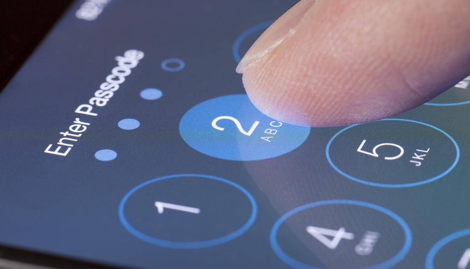 Finger entering phone passcode showing decision on Fifth Amendment