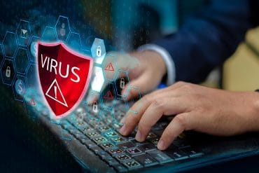 Man working on computer with protective shield showing antivirus is not enough