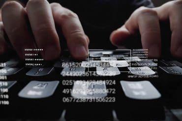 Man working on laptop computer keyboard showing worsening cybersecurity skills gap