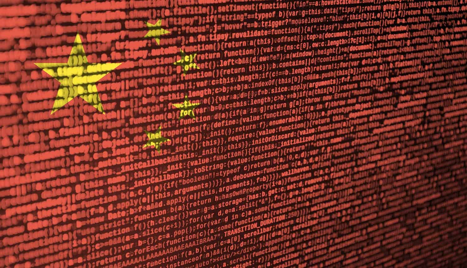 China flag is depicted on the screen with the program code showing use of Taidoor malware attack for cyber espionage