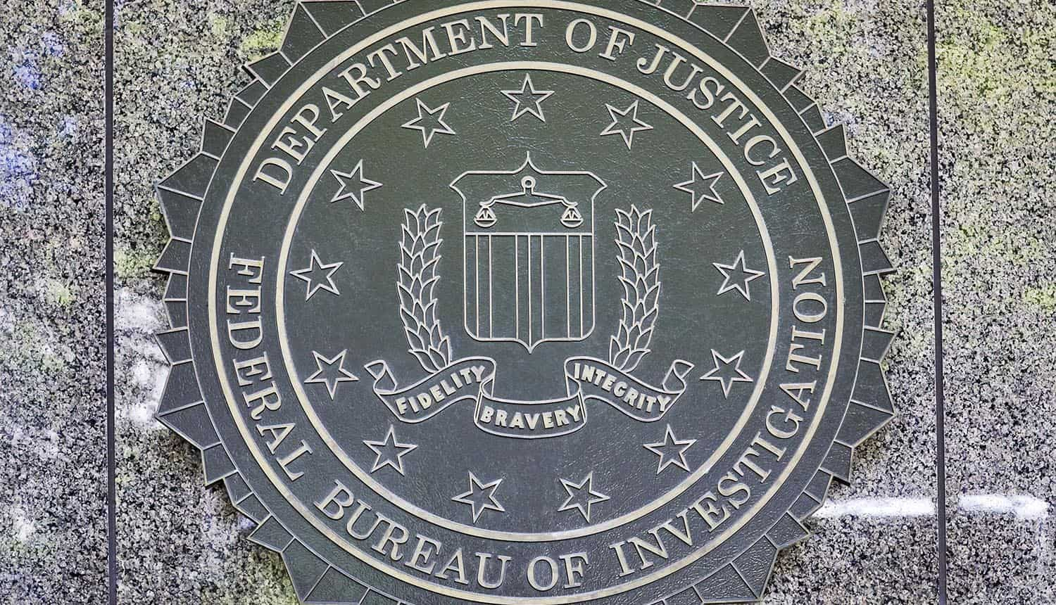 Emblem on the side of the FBI Building showing FISA Court ruling on warrantless surveillance and warning on privacy rules